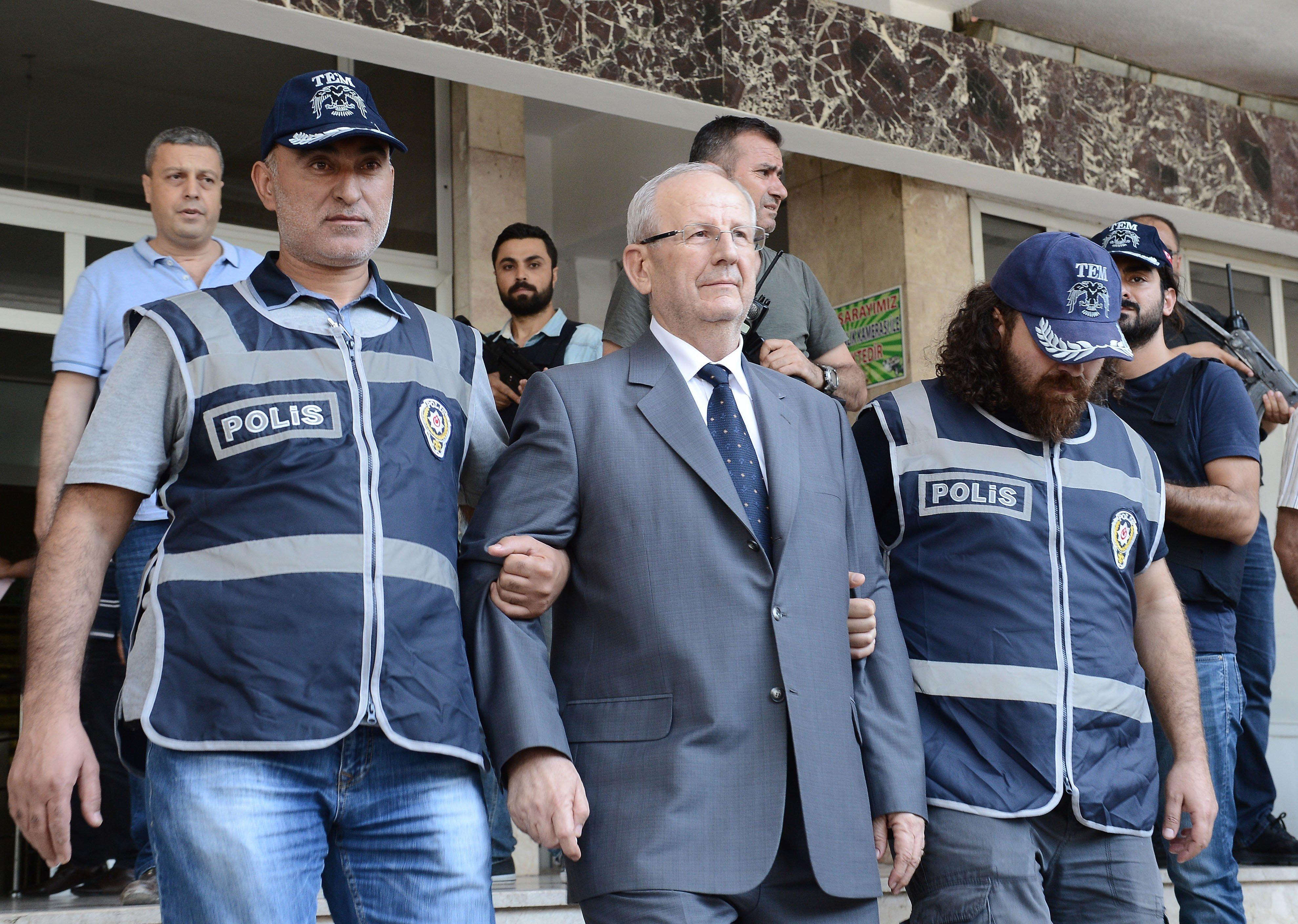 MALATYA, TURKEY - JULY 18: Turkish Second Army Commander General Adem Huduti (C) is arrested following the failed Parallel State/Gulenist Terrorist Organization's military coup attempt, in Malatya, Turkey on July 18, 2016.  (Photo by Volkan Kasik/Anadolu Agency/Getty Images)