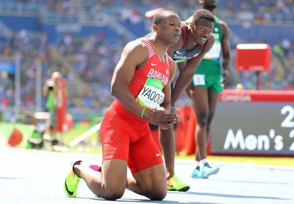 Salem Eid Yaqoob of Bahrain prays after Men's 200m heats.
