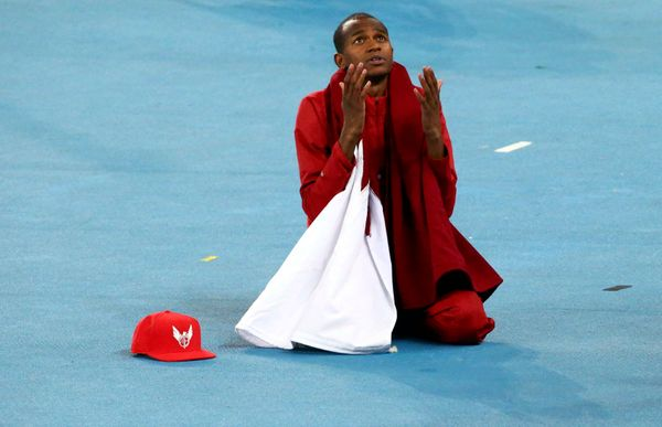 Mutaz Essa Barshim of Qatar prays after winning silver during the Men's High Jump Final.