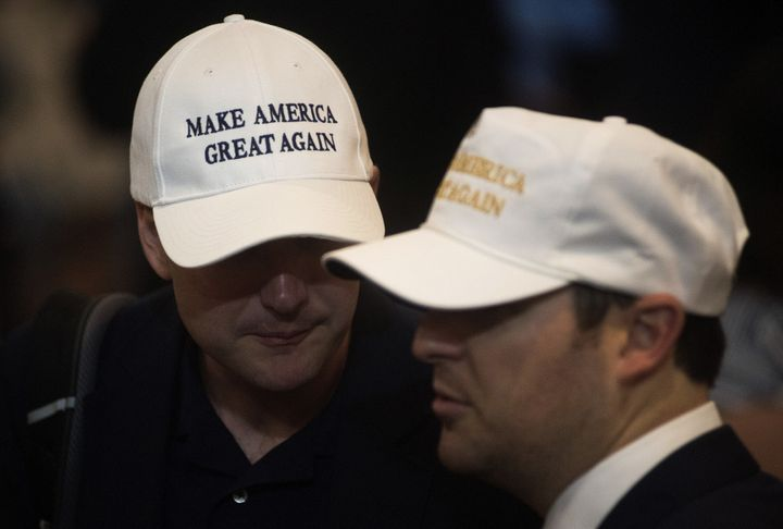Attendees wear hats reading 'Make America Great Again' during a goodbye reception with Donald Trump, 2016 Republican presiden