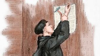 Martin Luther (1483-1546). German reformer. Luther hanging his 95 theses in Wittenberg, 1517. Engraving in Germania, 1882. Colored. (Photo by: PHAS/UIG via Getty Images)