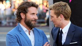 HOLLYWOOD, CA - AUGUST 15:  Actors Bradley Cooper (L) and Miles Teller attend the premiere of Warner Bros. Pictures' 'War Dogs' at the TCL Chinese Theatre on August 15, 2016 in Hollywood, California.  (Photo by David Livingston/Getty Images)