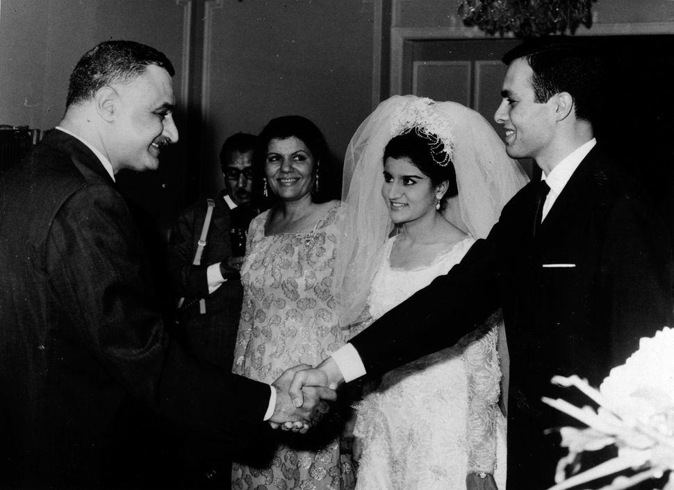 Nasser shakes hands with Marwan at the wedding.