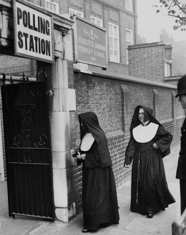 Nuns arrive at a polling station in 1959.