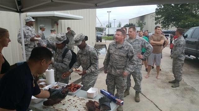 Officers enjoy some of Dornhorsts' food.