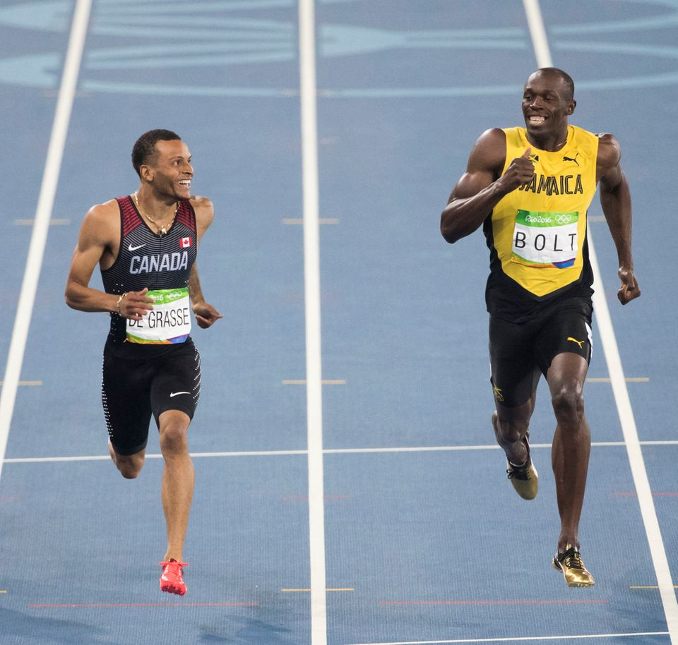 Usain Bolt Could Only Laugh As Andre De Grasse Tried To Pass