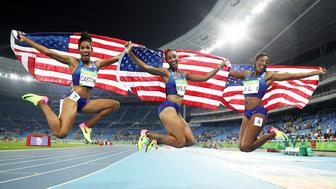 RIO DE JANEIRO, BRAZIL - AUGUST 17:  (L-R) Bronze medalist Kristi Castlin, gold medalist Brianna Rollins and silver medalist Nia Ali of the United States celebrate with American flags after the Women's 100m Hurdles Final on Day 12 of the Rio 2016 Olympic Games at the Olympic Stadium on August 17, 2016 in Rio de Janeiro, Brazil.  (Photo by Cameron Spencer/Getty Images)
