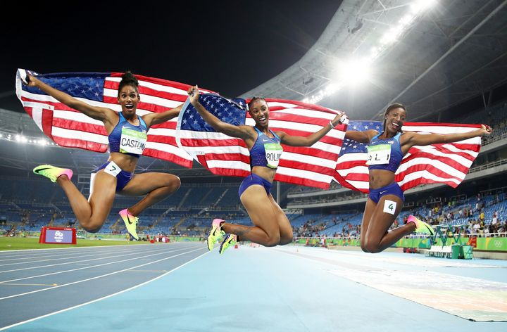 Bronze medalist Kristi Castlin, gold medalist Brianna Rollins and silver medalist Nia Ali of the United States celebrate with