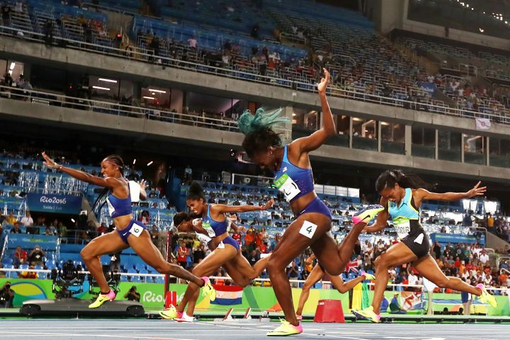 Brianna Rollins of the United States (L) wins the gold medal in the Women's 100m Hurdles Final.