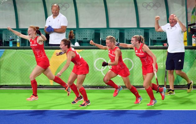 Britain's players celebrate after winning the women's semifinal field