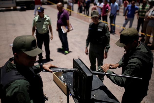 Venezuelan National Guard destroy a weapon during an exercise to disable seized weapons in