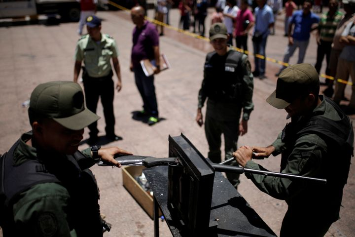 Venezuelan National Guard destroy a weapon during an exercise to disable seized weapons in Caracas.
