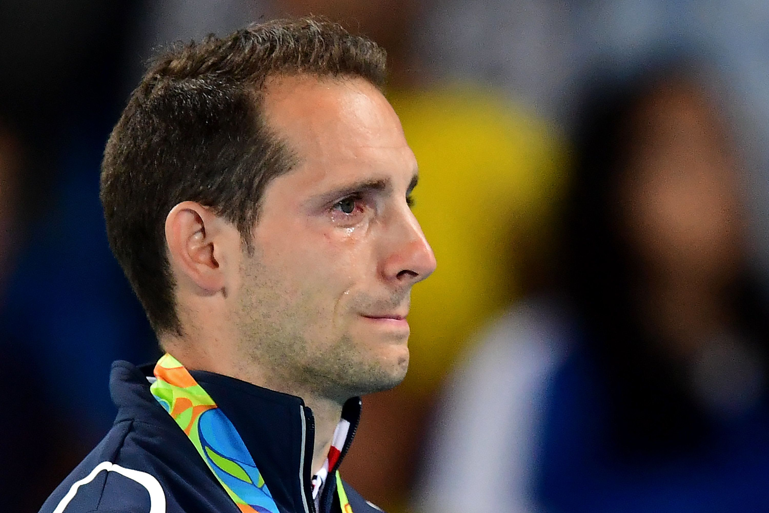Renaud Lavillenie cries on the podium as the crowd boos him for the second straight night.