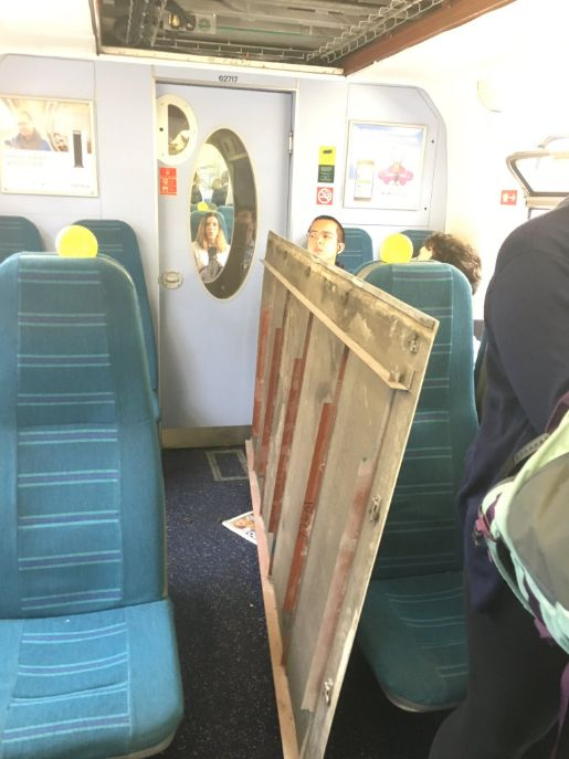 Bemused passengers look upon the