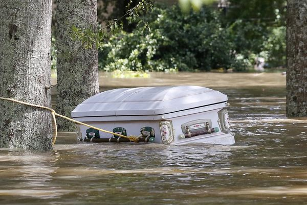 A casket is seen floating in flood waters in Ascension Parish, Louisiana, on Aug. 15.