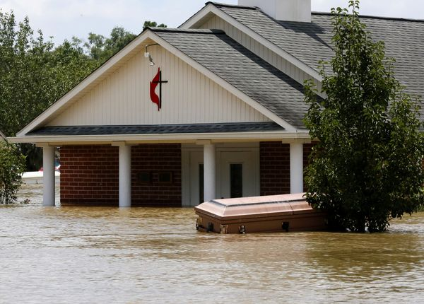 A casket is seen in front of a partially submerged church in Ascension Parish on Aug. 15.