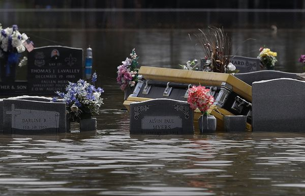 A casket is seen in a flooded cemetery on Aug. 17 in Sorrento, Louisiana.