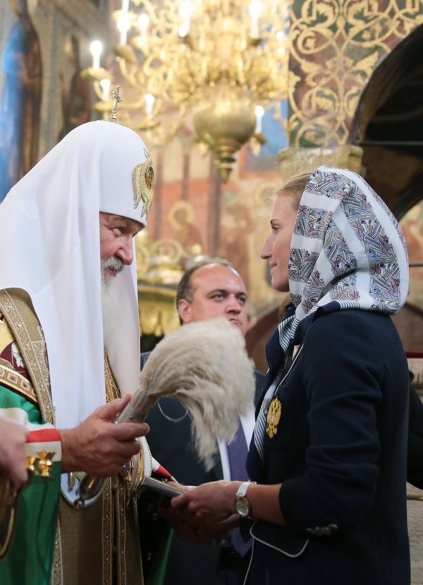 Patriarch Kirill of Moscow and all Russia (L) blesses members of the Russian Olympic team during a prayer service at the Assu