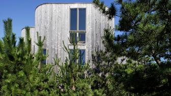 Horace Gifford designed 1960's mid-century modern wood beach house on Fire Island at The Pines, surrounded by pine trees.