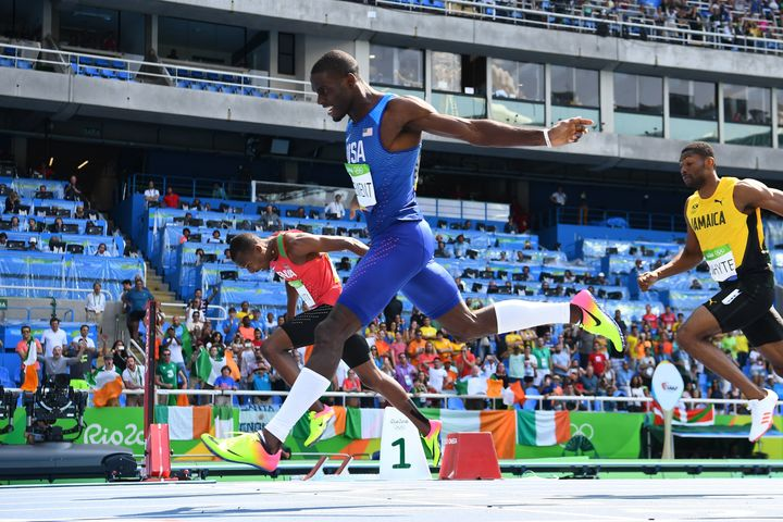 Kerron Clement crosses the finish line first in the 400 hurdles final.