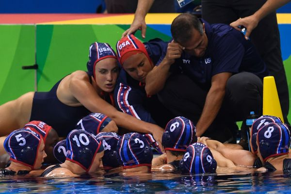USA's team prays before the Rio 2016 Olympic Games women's water polo semifinal game against Hungary at the Olympic Aquatics