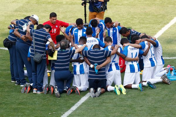 Players of Honduras pray together after being defeated by Brazil 6-0 in a Rio 2016 Olympic Games men's football semifinal mat