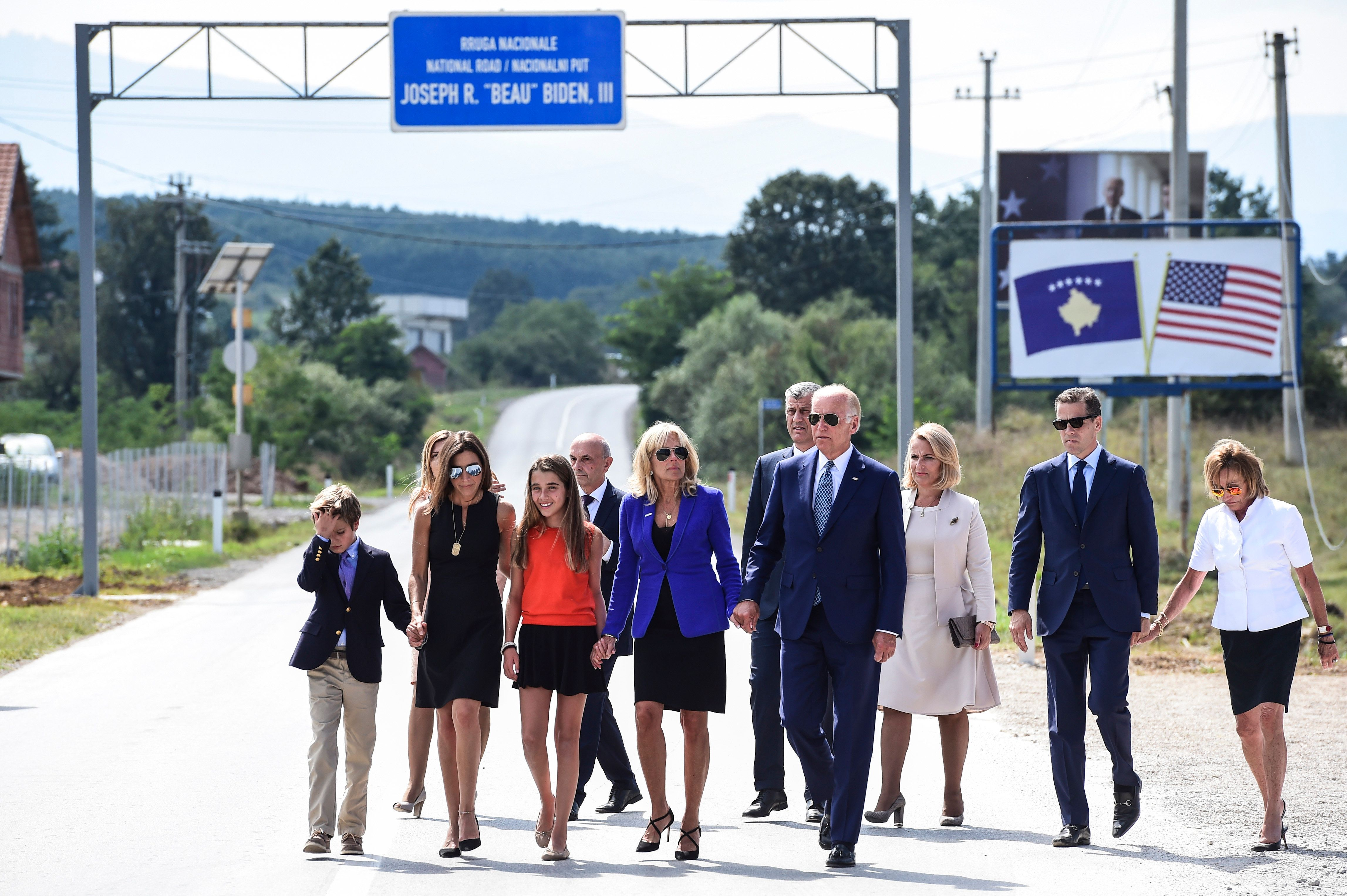 US Vice President Joe Biden (C) joined by his wife Dr Jill Biden and other family members walk on a national road named after their late son Joseph 'Beau' Biden, near the village of Sojevo on August 17, 2016. / AFP / ARMEND NIMANI        (Photo credit should read ARMEND NIMANI/AFP/Getty Images)