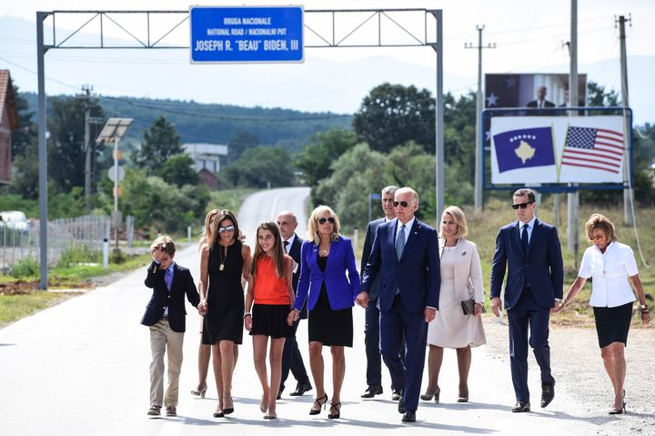 U.S. Vice President Joe Biden, joined by his wife Dr. Jill Biden and other family members, walks on a national road named aft