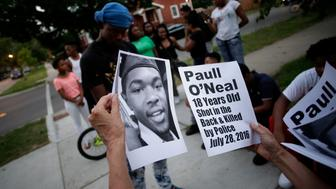 CHICAGO, IL - AUGUST 5: Demonstrators distribute photos of Paul O'Neal before protesting his fatal shooting by a Chicago police officer August 5, 2016 in Chicago, Illinois. O'Neal, an unarmed 18-year-old man was shot and fatally wounded July 28, when Chicago Police officers tried to arrest him for allegedly stealing a Jaguar car from the suburbs. The Chicago Police department released videos of the shooting to the public and media, which was captured by body cameras and dashboard cameras. (Photo by Joshua Lott/Getty Images)