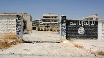An image grab taken from an AFP video dated from August 12, 2016 shows a school that was used by Islamic State (IS) group's fighters to manufacture explosives in the northern Syrian town of Manbij, almost a week after the Syrian Democratic Forces (SDF), a coalition of Arab and Kurd fighters, seized the group's stronghold.  / AFP / STR        (Photo credit should read STR/AFP/Getty Images)