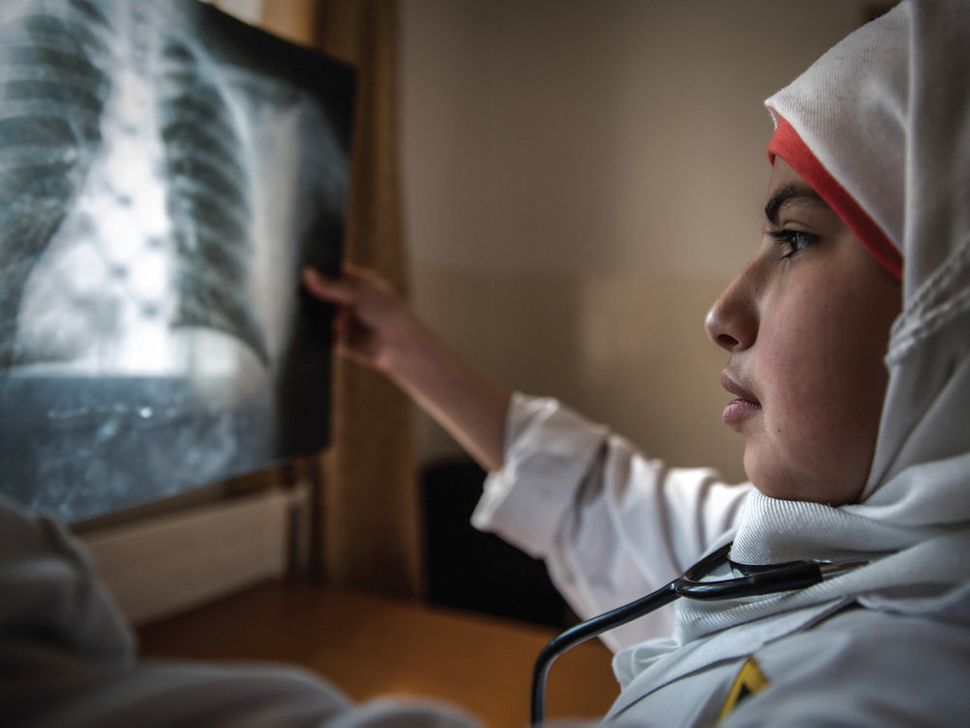 "<strong>Fatima, Jordan,&nbsp;future surgeon:</strong>&nbsp;""In this image, I am examining an X-ray of a patient to see what i"