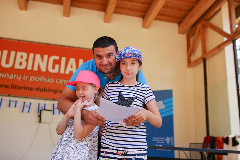 Daniel Tsomik and his two daughters making lasting memories at a Jewish family camp in the Baltics