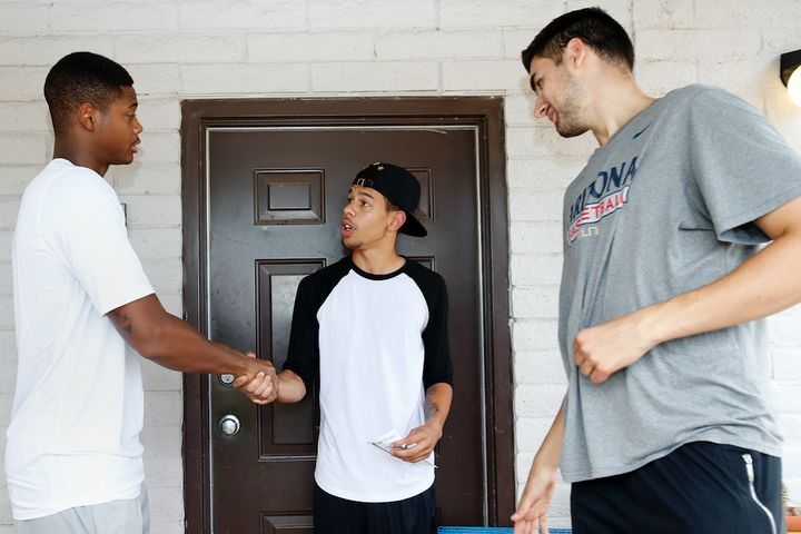 University of Arizona basketball players talk with a high school dropout about why he should return to school.