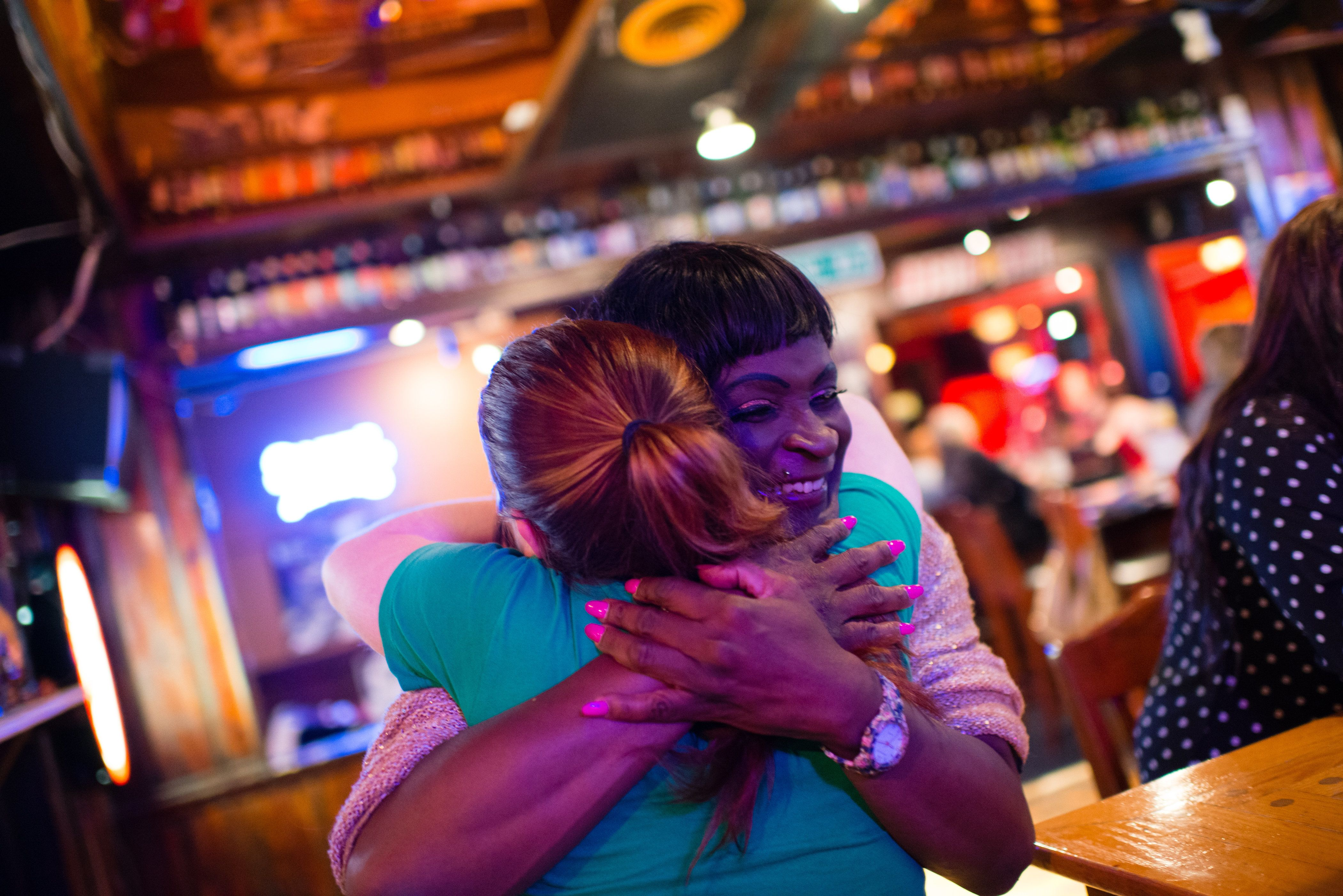 COLUMBIA, MD - JUNE 27:  Sara Simone is a transgender woman living in Alexandria, VA. She transitioned from male to female in 2011.  She is pictured at Second Chance Saloon in Columbia, MD where she met with some friends. Simone give a big hug to Sydney McFadden, of College Park. When Simone was homeless, McFadden came to her aid and let her stay in her apartment. (Photo by Sarah L. Voisin/The Washington Post via Getty Images)