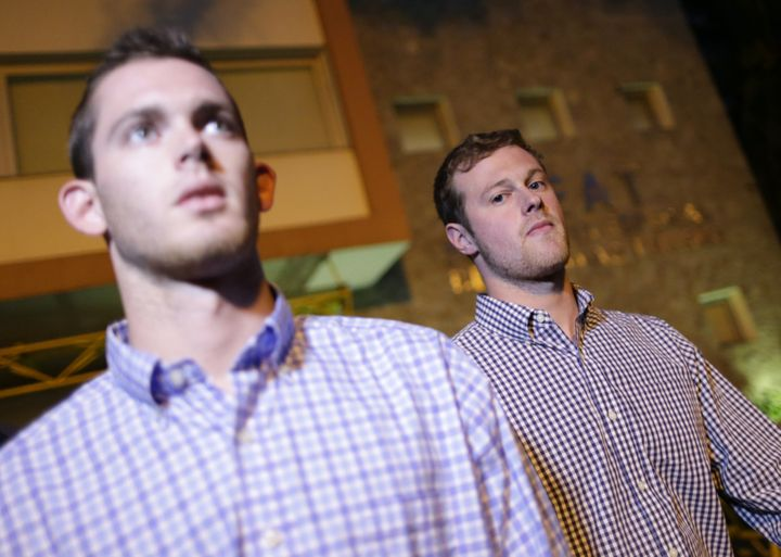 U.S. Olympic swimmers Jack Conger and Gunnar Bentz leave a police station after being questioned in Rio de Janeiro.