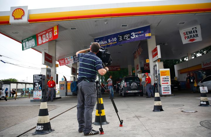 A television cameraman films at the gasoline station where U.S. swimmers Ryan Lochte, Jimmy Feigen, Jack Conger and Gunnar Be