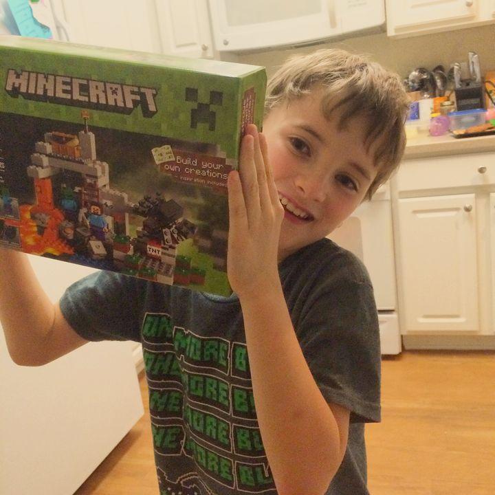 Ryan with a Minecraft birthday present.
