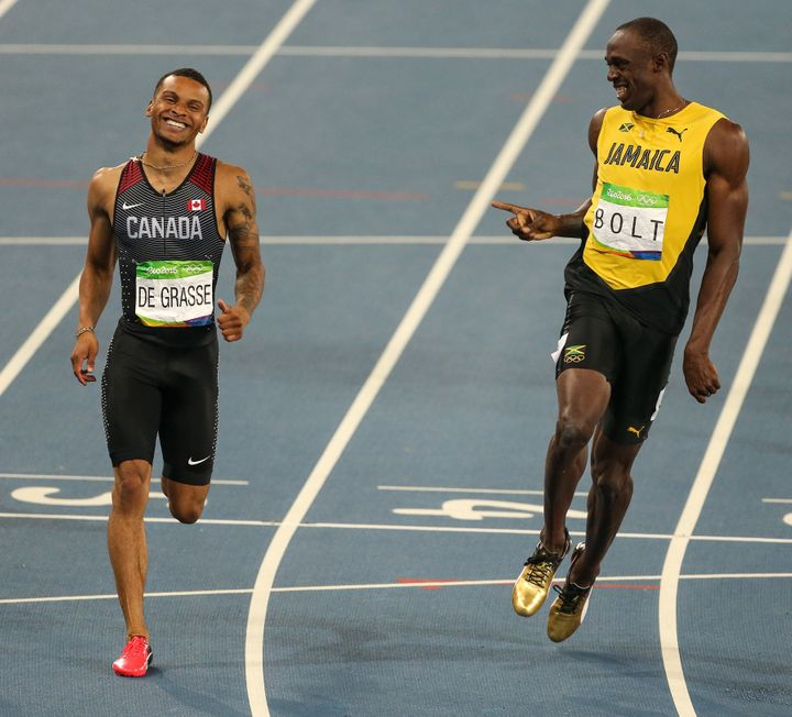 Bolt and De Grasse laugh following a semi-final of the men's 200-meter dash.