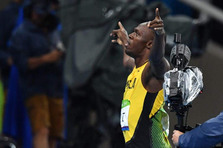 Usain Bolt celebrates after winning the Men's 200m Final at the 2016 Olympic Games in Rio de Janeiro on August 18, 2016.