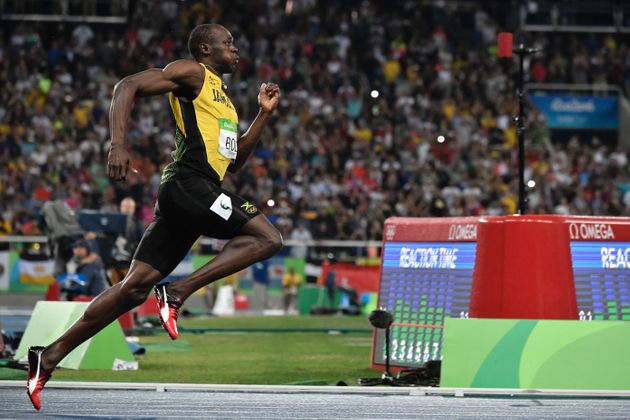 Usain Bolt competes in the men's 200m Final at the Rio 2016 Olympic Games at the Olympic Stadium in Rio...