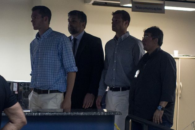 Gunnar Bentz (F-L) and Jack Conger (2nd from R) are seen leaving the police station after