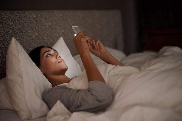 Scientists May Have Found A Way We Can Use Our Phones Before Bed Without Ruining Our