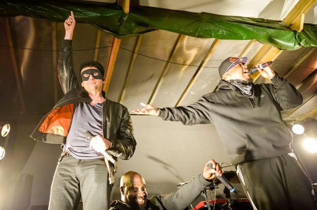 Blur's Damon Albarn joined De La Soul on stage during a concert at Banksy's