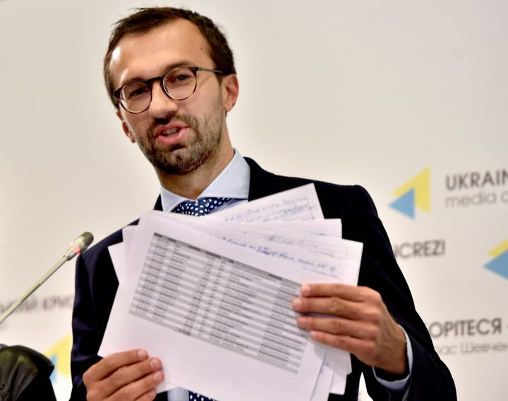 Ukrainian lawmakerSerhiy Leshchenko holds pages he alleges show signedpayments fromthe party of Ukraine's f