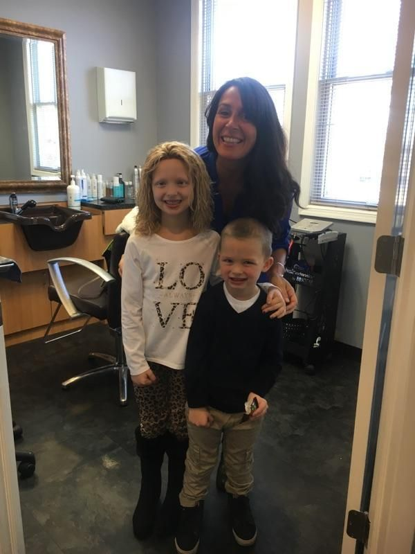 Amelia Sholty with Transitions Hair Solutions owner Danielle Marzella Grillo and her little brother Liam.