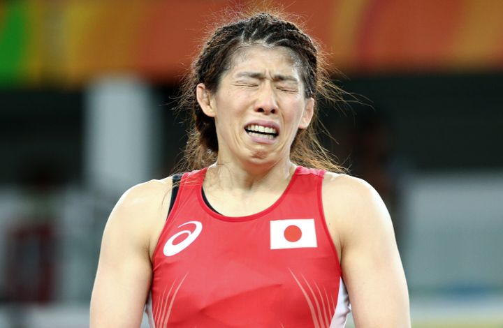 The beaten legend, Saori Yoshida, weeps in disappointment afterward.