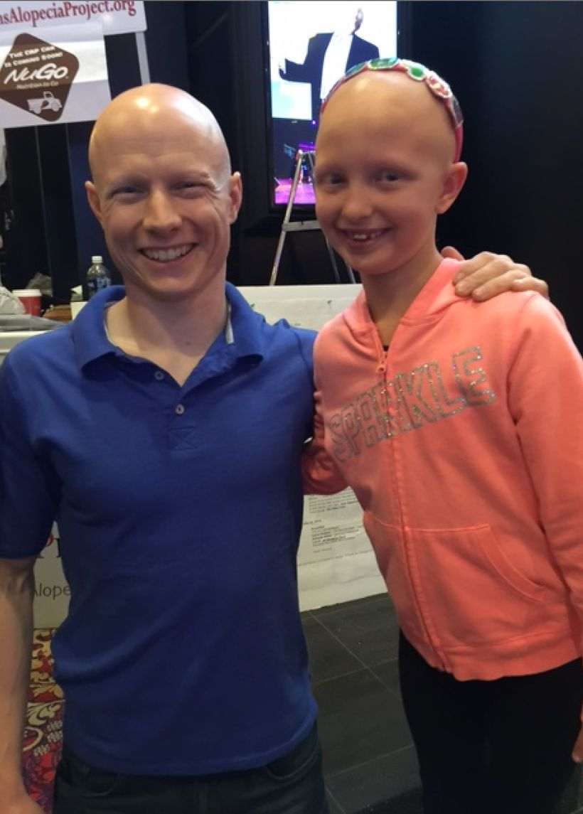 Amelia with Kevin Bull from 'American Ninja Warrior' at the Children's Alopecia Project conference in Las Vegas Ju