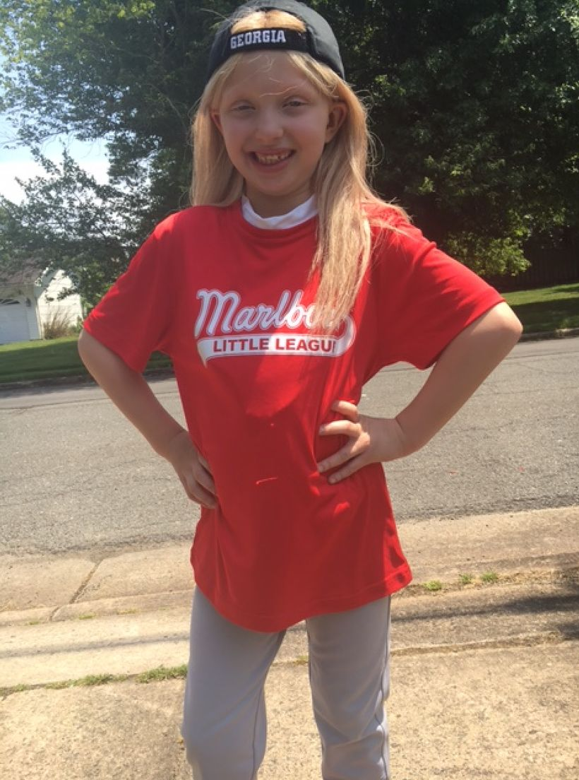 Amelia dressed for baseball this summer.