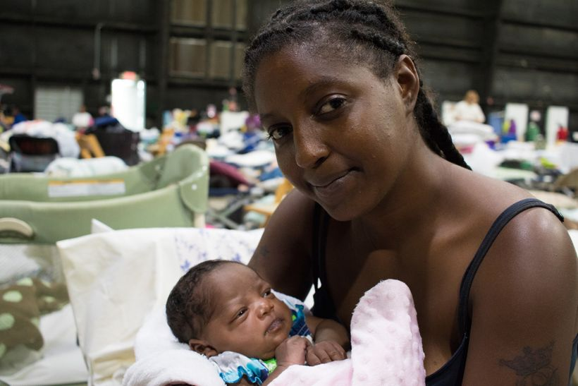 <i>Vernesha and her 3-week-old baby niece, Joy, are staying at a shelter in Baton Rouge after being driven from their home by