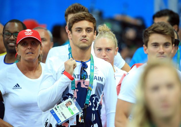 Gold medal hope: Tom Daleylooks to the scoreboard following the Women's 3m Springboard Final on